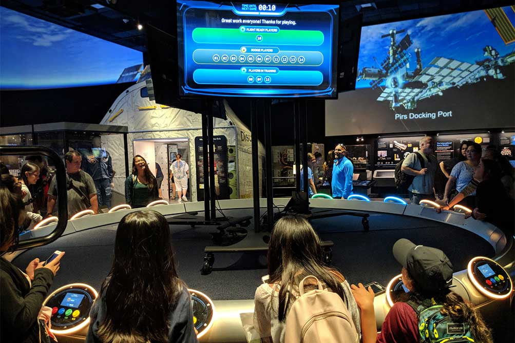 People playing the Space Flight Academy multi-user game.