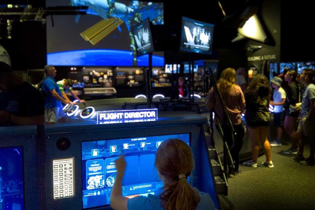Young girl acts as the Flight Director for a Space Flight Academy game session.
