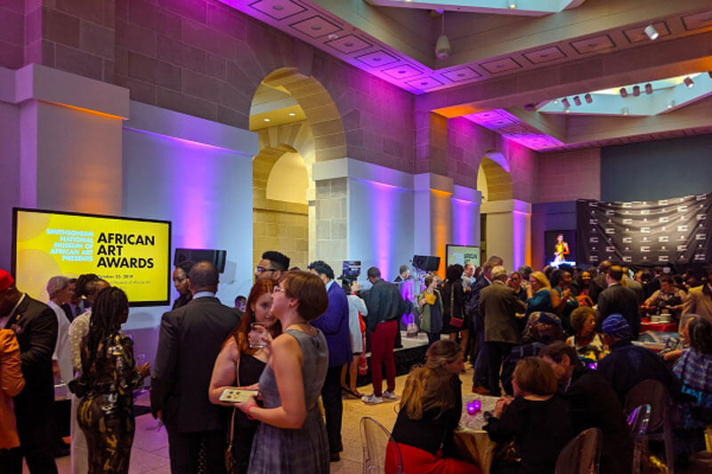 People enjoying the Smithsonian African Art opening gala
