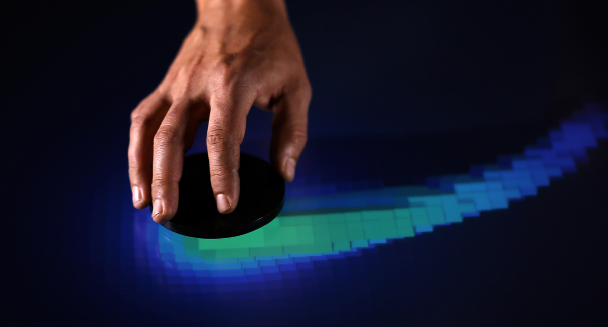 Tangible being moved across the surface of an Ideum Multitouch table.