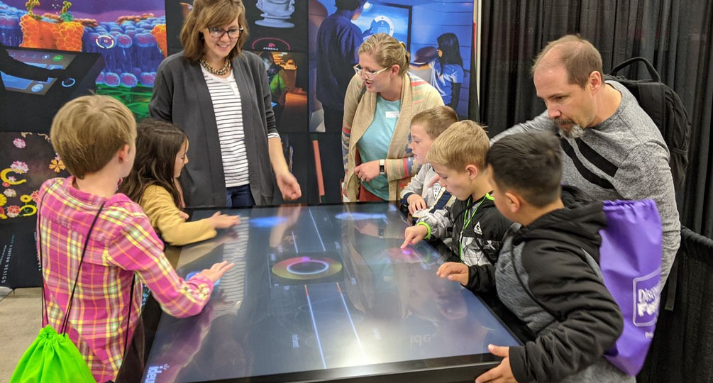 Ideum engages community members with interactive touch-table experience.