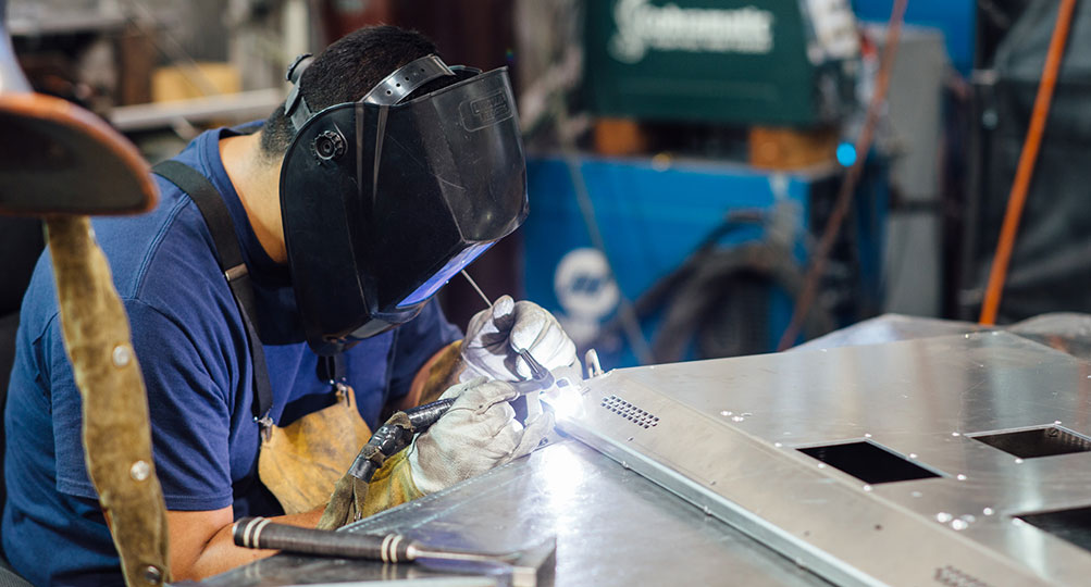 Welding can create tough displays, but it is labor intensive and tolerances can vary.