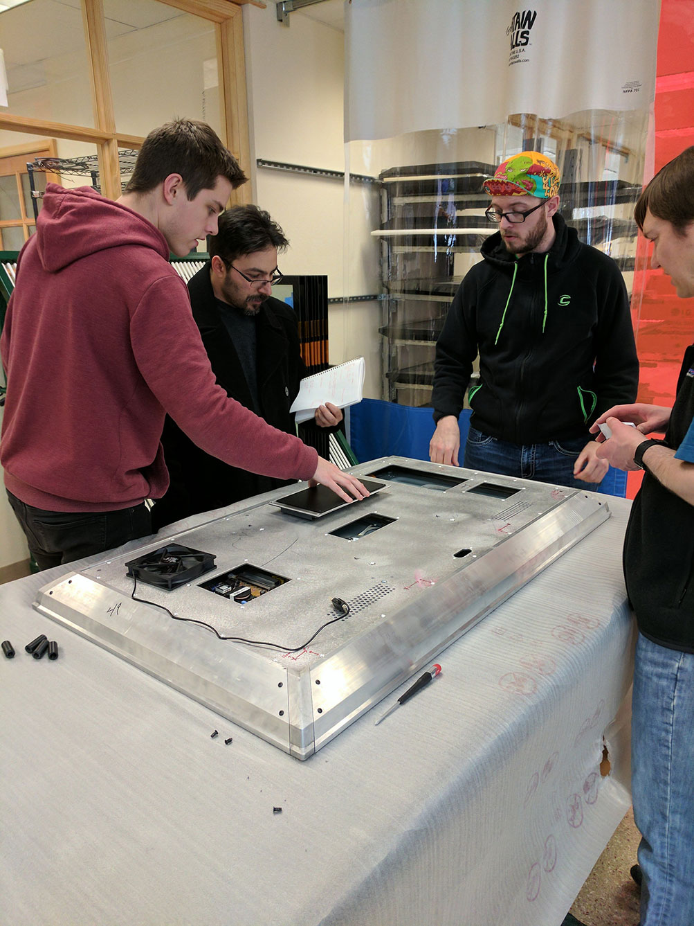 Our Industrial Design team and members of the production group discuss an early prototype.
