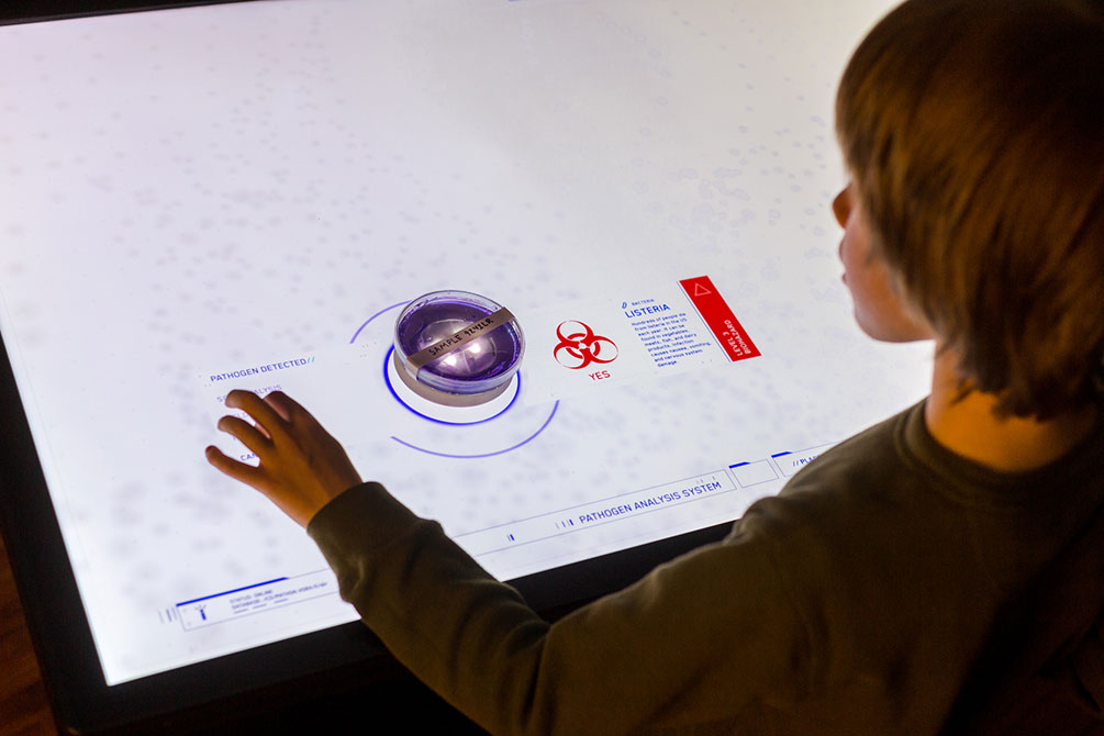 Exhibit Uses Tangibles to Explore Pathogens on a multitouch table.
